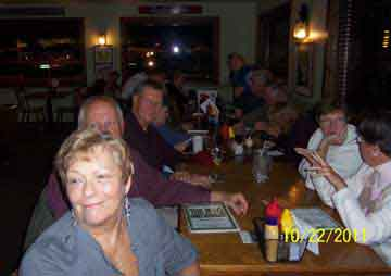 Carol Defranc, Bob Zewsky then Charlie Roberts with their wives directly accross from them